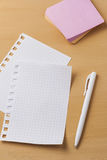 A sheet for notes on a wooden table.  Stock Image