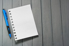 A sheet for notes on a wooden table.  Stock Images