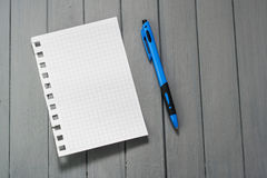 A sheet for notes on a wooden table.  Stock Photography