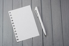 A sheet for notes on a wooden table. Stock Photos