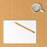 Sheet of office paper, yellow pencil and cup of coffee. Royalty Free Stock Images