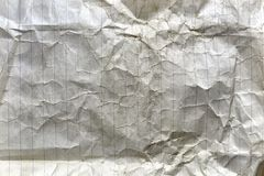 Crumpled old lined white paper. Sheet of old crumpled lined white paper Stock Images
