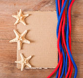 Sheet of old paper, rope and starfish Royalty Free Stock Image