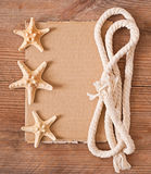 Sheet of old paper, rope and starfish Royalty Free Stock Photography