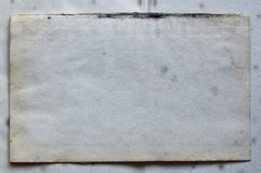 Old textured paper-background image. Sheet of old paper with stains of mold and stains pattern stock image