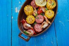 Sheet Pan Shrimp Boil. Traditionally, you combine corn, shrimp, sausage, seasonings royalty free stock image
