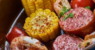 Sheet Pan Shrimp Boil. Traditionally, you combine corn, shrimp, sausage, seasonings stock image