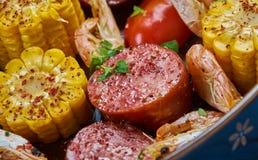 Sheet Pan Shrimp Boil. Traditionally, you combine corn, shrimp, sausage, seasonings royalty free stock photography