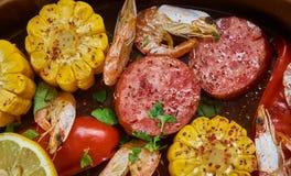 Sheet Pan Shrimp Boil. Traditionally, you combine corn, shrimp, sausage, seasonings royalty free stock images