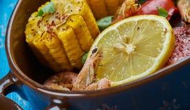 Sheet Pan Shrimp Boil. Traditionally, you combine corn, shrimp, sausage, seasonings royalty free stock photos