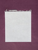 Sheet of paper. Sheet of white lined paper on the violet background Royalty Free Stock Images