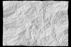Sheet of paper. White sheet of paper on black background Royalty Free Stock Image