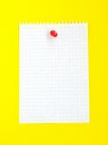 Sheet of paper. Sheet of white lined paper on the yellow background Royalty Free Stock Photo