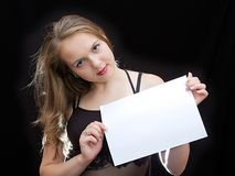 Sheet of paper. Girl hold a sheet of paper Royalty Free Stock Images