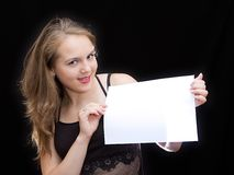 Sheet of paper. Girl hold a sheet of paper Stock Photos