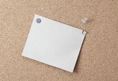 Sheet of paper attached to a pushpin noticeboard. Royalty Free Stock Photos