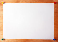 Sheet of paper attached to wooden board royalty free stock images