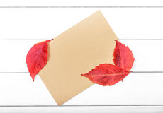 Sheet of paper with autumn leaves. Royalty Free Stock Photo