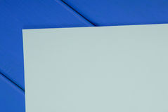 Sheet of paper is on blue table Royalty Free Stock Photo