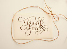 Sheet of paper with bow  and text thank you. Greating card Stock Photos