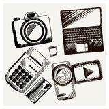 Sheet of paper with camera laptop cash mashines. Business doodles icons Sheet of paper with video camera laptop cash mashines in sketch style Royalty Free Stock Photo