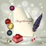 Sheet of paper, Christmas balls, ink pot and a fea. Ther over bright background Royalty Free Stock Images