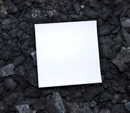 Sheet of paper on coal Stock Photo