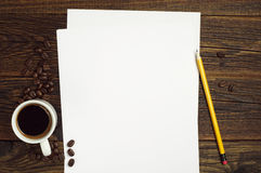 Sheet of paper and coffee Stock Images