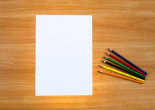 Sheet of paper and colored pencils Royalty Free Stock Photos