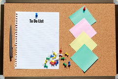 Sheet of paper with cork board, pen, colorful push pin and stick Royalty Free Stock Photography