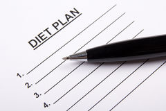 Sheet of paper with diet plan and pen Stock Image