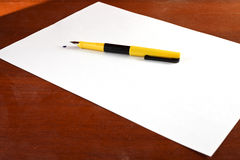 Sheet of paper, feather and blot Royalty Free Stock Photography