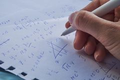Sheet of paper filled with calculations as a background. Math problems on graph with pencil. Doing algebra some school. Sheet of paper filled with calculations Royalty Free Stock Photography