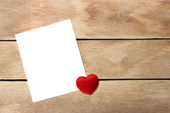 A sheet of paper with a heart. Not a wooden background Stock Images