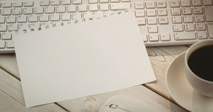 Sheet of paper on keyboard Stock Images