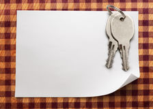 Sheet of paper with keys Royalty Free Stock Photography