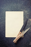 Sheet of paper with knives Stock Images