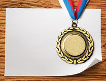 Sheet of paper with medal Stock Image