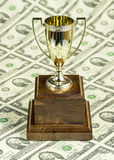 Sheet of paper money with a trophy cup Stock Images