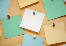 Sheet of paper for notes. Color sheets of paper for notes pinned by pins on the wall Stock Image