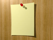 A sheet of paper for notes pinned to a wooden wall button. Royalty Free Stock Photos