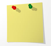 A sheet of paper for notes pinned by two buttons to a white surf Royalty Free Stock Images