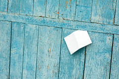 Sheet of Paper on Old Blue Wooden Background. Royalty Free Stock Photos