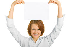 Sheet of paper over her head. A girl holding a sheet of paper over her head. Shallow DOF. Focus is on the hands and sheet Stock Images