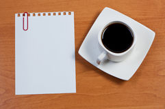 Sheet paper with paperclip and cup coffee. Royalty Free Stock Photography