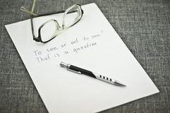 A Sheet of Paper and a Pen and Glasses on It Stock Photography