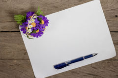 A sheet of paper with a pen on wooden office desk Royalty Free Stock Photo