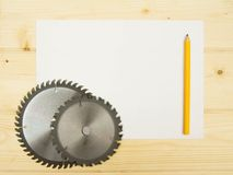 The Sheet of paper with pencil and circle saw on Stock Images