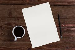 Sheet of paper with a pencil and coffee royalty free stock photography