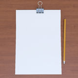 Sheet of paper and pencil on the wood table Royalty Free Stock Photo
